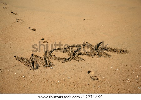 """Message says """"WORK""""  in the Sand on a Beach with waves and blue ocean concepts - stock photo"""