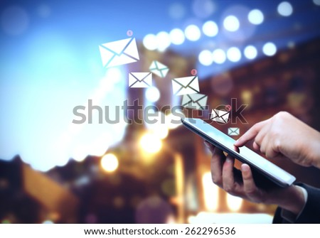Messages anywhere and to anyone with tablet - stock photo