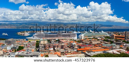 MESSINA, ITALY - MAY 17, 2012: MSC Splendida, and Voyager of the Seas are docked in the port of Messina. Over 7,000 passengers went out to visit famous island. Sicily, Italy.
