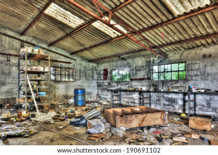 Messy abandoned workshop - stock photo