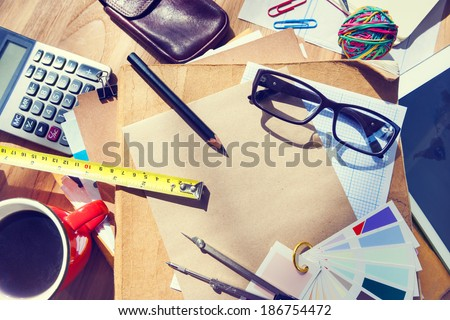 Messy Architect's Table with Work Tools - stock photo