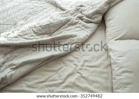 Messy bed with two pillows in the morning. - stock photo