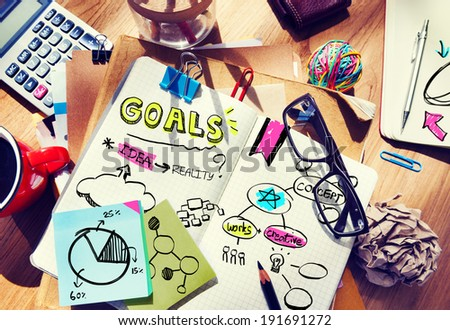 Messy Designer's Table with Notes and Tools - stock photo