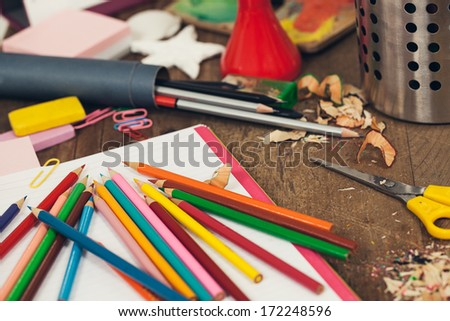 Messy desk of a primary school student. - stock photo