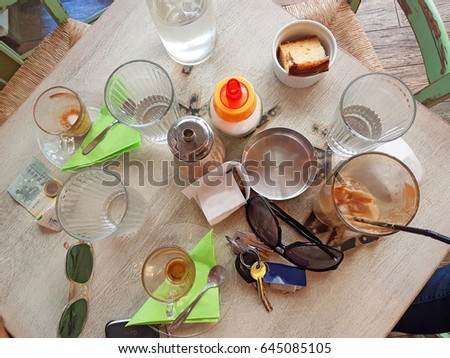 Messy Restaurant Table Cafe Full Things Stock Photo Edit Now - Things found on a restaurant table