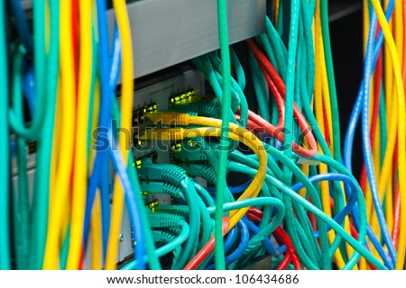 Messy router connections in a data center - stock photo