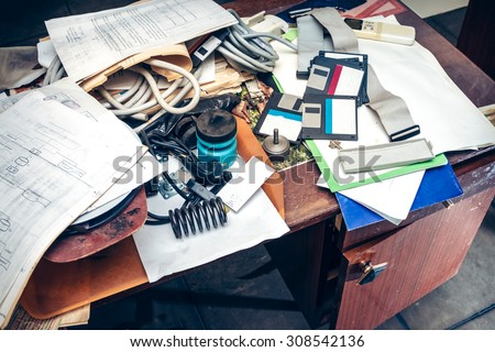 Messy workplace with stack of paper on table - stock photo