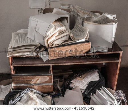 Messy workplace with stack of the paper - stock photo