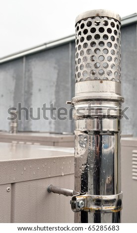 Metal air conditioning vent detail in bad weather - stock photo