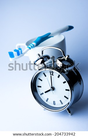 Metal Alarm clock, wake up time, 8 am. on white background  - stock photo