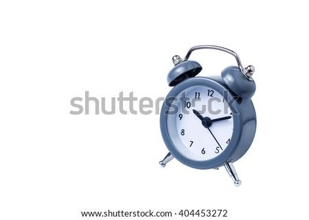 Metal Alarm clock work time on white background - stock photo