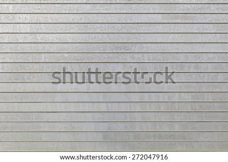 Metal aluminium siding wall horizontal stripes aged rust spots - stock photo