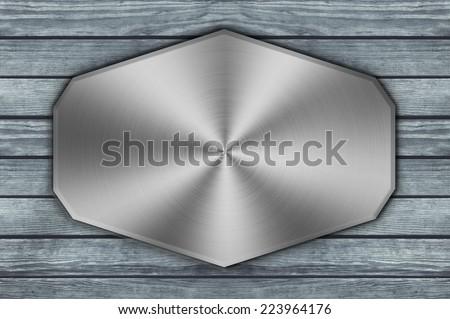 metal aluminum plaque on wood background  - stock photo