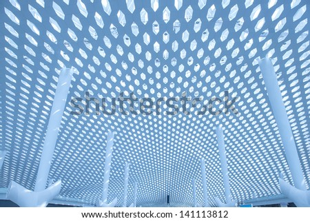 metal and glass roof of a mall - stock photo