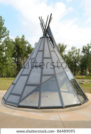 metal and glass teepee statue - stock photo