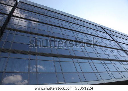 metal and glass wall construction on blue sky background