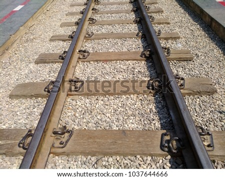metal and wood old train rails to the bridge over Kway river in Thailand on kurkar stones