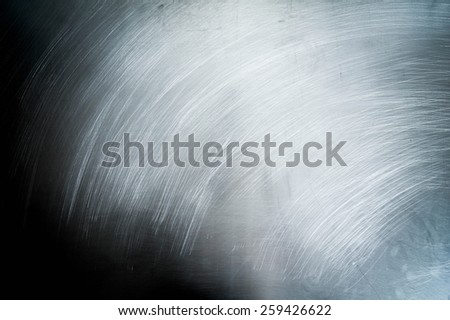 Metal background. Grange a background. Metal sheet in scratches.