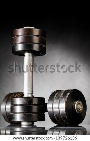 metal barbells on dark gray background - stock photo