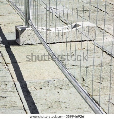 Metal barrier in a stone road - concept image