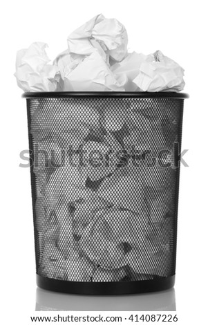 Metal basket with paper waste isolated on white background. - stock photo