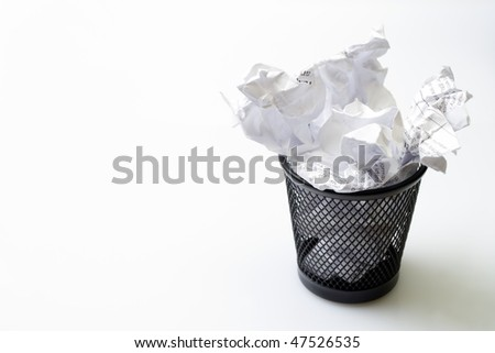 Metal basket with papers garbage