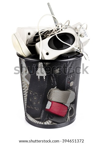 Metal bin full of used electronic garbage on white background - stock photo