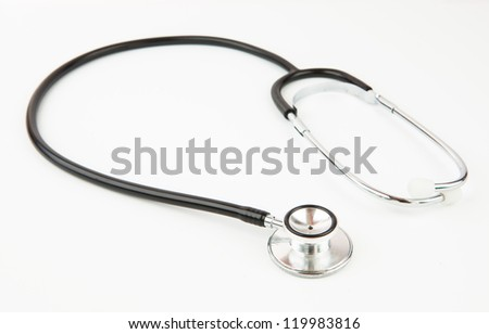 Metal black stethoscope on white background