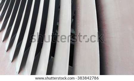 Metal blades of a steam turbine in a power plant - stock photo