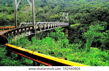 Metal bridge on the way to Volcano Arenal and La Fortuna, Costa Rica. - stock photo