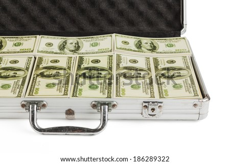 Metal Briefcase full with dollar banknotes isolated on white background - stock photo