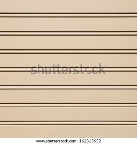 Metal brown shutters over a shop doors - stock photo