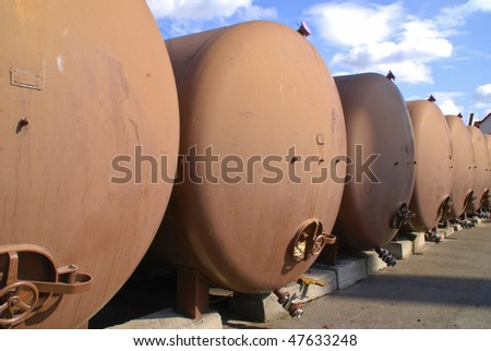 Metal brown tanks for fuel storage in a row - stock photo
