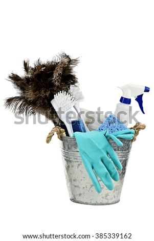 Metal bucket with cleaning supplies isolated on white background. - stock photo