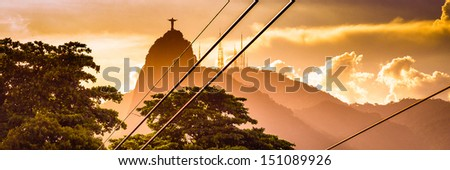 Metal cables with the Christ The Redeemer statue in the background, Corcovado, Rio de Janeiro, Brazil - stock photo
