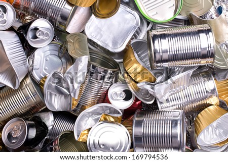 Metal cans and tins prepared for recycling - stock photo