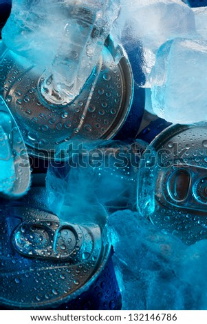 Metal cans in a refrigerator covered with ice