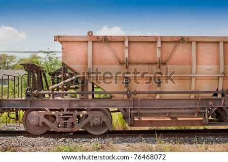 Metal cargo train container on railway at the station. - stock photo