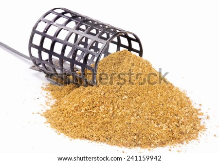 Metal case carp fishing feeder - stock photo