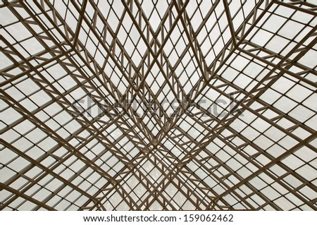 Metal ceiling beams supporting a glass structure - stock photo