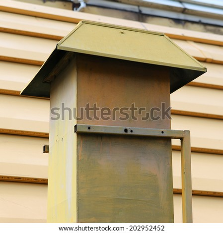 Metal chimney on the roof - stock photo