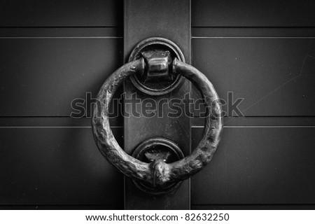 metal circle door knocker  black and white - stock photo