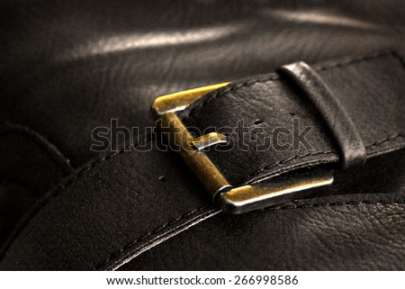 Metal clasp on old leather case with stitching - stock photo