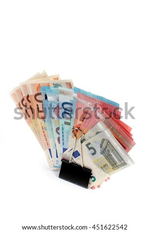 metal clip and a small pile of paper euro banknotes