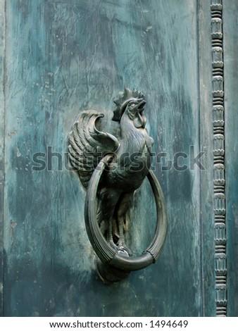 Metal cock on steel strong door - stock photo