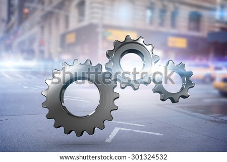 Metal cogs and wheels connecting against blurred new york street - stock photo