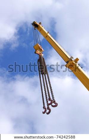 Metal crane on a blue sky - stock photo