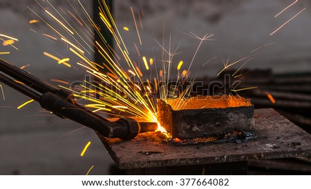 Metal cutter, steel cutting with acetylene torch, industrial worker on working area