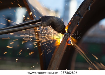 metal cutting with acetylene torch - stock photo