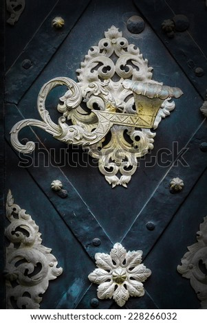 metal decorated door with handle as figure - stock photo